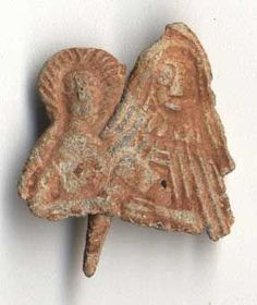 Lead pilgrim badge, depicting St Anne teaching the Virgin Mary to read. Possibly from her shrine at Buxton, Derbyshire, but relics of St Ann...