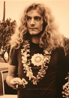 Robert Plant  -- Led Zeppelin  I don't know how he does it, but he pulls off that lei and long hair