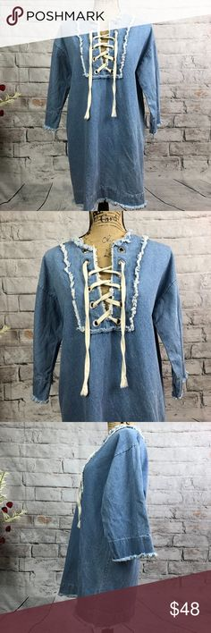 """Storets Trendy BOHO Denim Lace Up Dress Storets Trendy BOHO Denim Lace Up Dress Stylish Lace up. Factory distressing. 3/4 sleeve Could be worn as Tunic with leggings. 100% cotton  Pre-loved in excellent condition  Pit to pit approx. 20"""" Length approx. 32""""  Thank you for checking out our closet. Please feel free to bundle and save! Storets Dresses Midi"""