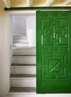 textured barn doors - carved geometric panel green painted barn door - Simply Decorate via Atticmag