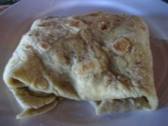 Roti - this one is filled with curried conch. Conch, Grenadines, Caribbean, Menu, Bread, Foods, Dinner, Fruit, Night