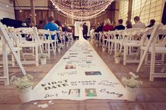 "The walk down the aisle is already incredibly emotional, but this ""flashback"" DIY aisle runner takes it to a whole new level! The couple included a crossword puzzle in their program, and most of the answers could be found on the aisle runner, so their guests had a fun game to play while they waited for the ceremony to start.Related: 200  Emotional Wedding Moments"