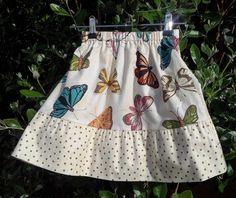 Toddler girl's skirt butterflies with beautiful brown polka dots.