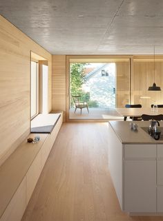 Interior Design Idea – Add a low cabinet along a wall to create a window seat and extra storage storage