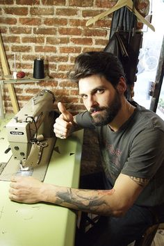 Is that a sewing machine, tattoos AND a beard?  I'm in love.