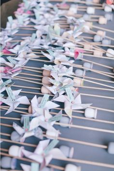 pinwheel escort cards | bryan miller photography | lvl events via boards.styleunveiled.com