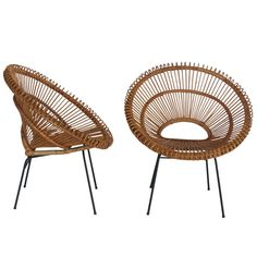 Rattan Bucket Chairs in the style of Franco Albini | From a unique collection of antique and modern lounge chairs at http://www.1stdibs.com/furniture/seating/lounge-chairs/