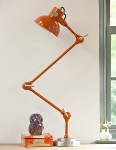 If we could only have 1 lamp in our home it would be this one. This truly magnificent and quirky lamp, comes in a choice of Blue or Orange and adds tons of retro chic to the home. Powder coated metal with heavy brushed metal base.  Adjustable at 3 parts. Takes an E27 bulb 60W. Comes with a european plug but we provide an adaptor.  As seen in Country Living.