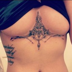 love the sternum piece with the words on the riiiiibbssss