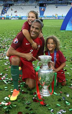 #EURO2016 Bruno Alves of Portugal and his children pose with the trophy following the UEFA Euro 2016 final match between Portugal and France at Stade de France...