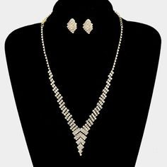 Visit: hipandcoolcliponearringstwo.com and receive up to 30% off. CLIP ON-GOLD CLEAR STONE V NECKLACE & EARRING SET  $15.99 http://hipandcoolcliponearringstwo.com