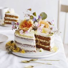 Triple Layered Carrot Cake topped off with a healthy dose of Cream Cheese Frosting and flowers.