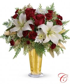 Golden Holiday. Mercury julep glass, with 2 Red roses, white asiatic lilies, red miniature carnations and white cushion pom pons.