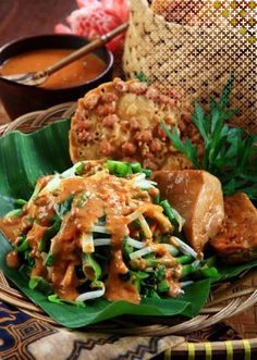 Pecel. vegetables such as long bean, sprout, spinach and (spicy) peanut sauce.
