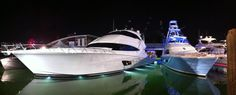 Nighttime view of the display at the Miami International Boat Show this February #luxury #yacht #sportfishing