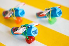 Airplane treats... a ring pop, stick of gum, two lifesavers, all held together with a colorful hair-tie