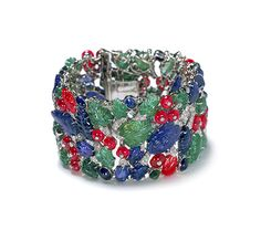 "Cartier - ""Tutti Frutti"" strap bracelet (circa 1929) - The platinum bracelet is set with diamonds, sapphires, emeralds and rubies. Mrs. Cole Porter, a/k/a Linda Lee Thomas, socialite and wife of composer Cole Porter, wore this bracelet."