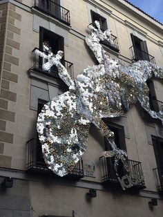Recycled CDs...I've seen this in person.  In the center of Madrid near Plaza Santa Ana.  Very cool!