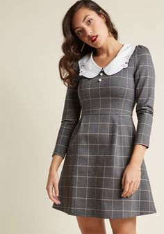 <p>If classic silhouettes with unexpected touches are right up your alley, you're going to adore this grey mini dress from Miss Patina! Crafted from structured knit fabric and enhanced with a navy-stitched kitty collar, white and tan plaid, and crisp pleats, this fun-loving frock is sure to 'whisker' you away.</p>
