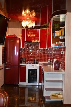 red kitchen- loving the red tile backsplash. Needs a little more white for some more dimension. :)) <3