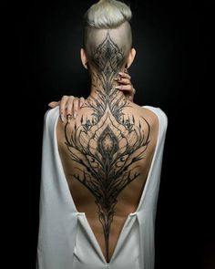 Enjoy body art brilliance with awesome back tattoos for men and women that are masterpieces. The back is one of the most spacious areas for tattoos on the body. If you are looking for the best full-back tattoo idea then this collection is for you. Head Tattoos, Body Art Tattoos, Tatoos, Tattoo Neck, Nape Tattoo, Chicano Tattoos, Full Body Tattoo, Tattoo Drawings, Trendy Tattoos