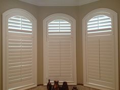 Beautiful custom plantation shutters in Master bathroom. Norman Woodlore Compsoite in 3 1/2'' Louver with traditional tilt bar, inside mounted.