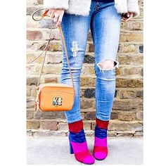 Our Fianna boots and Mariel x Boyarde bags add that splash of color on a cloudy day #LKBennett