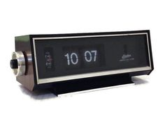 Very cool 1970s flip clock. This Linden Lighted Dial Alarm clock, model 963, is in very good shape. The clock works and keeps time. The alarm works