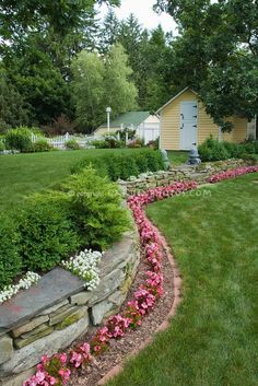 nice border ... stone wall, brick edging, evergreen plants, a bit of color in the foreground ~ we had a stone wall done in our front yard last summer....maybe i should try this border....