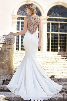 Glamorous, hand-embroidered fit-and-flare wedding dress with platinum cording illusion back,  contoured hourglass skirt, and chapel train of luxuriously brushed Bellagio Crepe. The back zips up under crystal buttons. {Dress by Martina Liana by @essensedesigns}