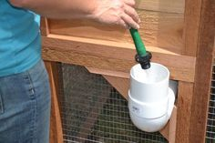 Round-Top Walk-In Chicken Coop | Urban Coop Company The easy fill waterer makes it easier than ever to give water to your chickens with out the hassle or mess of a hanging waterer!