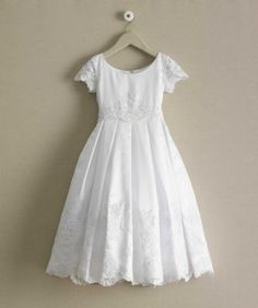 Silky white satin is kissed with lace appliqu at the hem and waist of this girls dress. First Communion Dresses from Chasing Fireflies. Girls Baptism Dress, Girls First Communion Dresses, Holy Communion Dresses, Girls White Dress, Little Girl Dresses, Girls Dresses, Flower Girl Dresses, Blessing Dress, Mint Dress