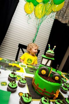Cute cake without cupcake on top of tractor