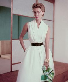 1952 Model is wearing an embossed white cotton coat-dress