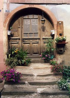 Arched entrance w welcoming plants - WELCOME HOME IN ALSACE,  FRANCE by PAROSCAR, via Flickr -
