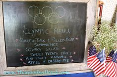 #Olympic menu displayed on a rustic frame from #Goodwill then painted with chalkboard paint.   $6.39  #USA #Party #thrift #red white & blue