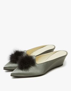 From TRADEMARK, a pointed toe slide in Sage. Feather detail. Leather lining. Padded footbed. Tonal stitching. Covered wedge heel with rubber cap.  • Satin upper • Leather sole • Made in Italy • Women's sizes listed