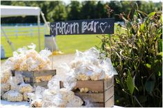 One economical idea is to have a popcorn bar at your reception... who doesn't love popcorn? Especially if you are having a casual wedding with lawn games, this gives guests something easy to snack on while they are playing around. So fun!  Elizabeth Henson - Hill City Bride #popcorn #wedding #budget