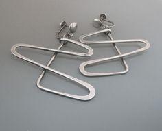 Earrings | Henry Steig.  Sterling silver.  c. 1950s In the 1960s, many women wore clip on or screw on earrings.