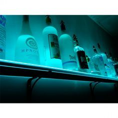 These cool new LED Lighted Liquor Bottle Shelves illuminate your finest booze just like the top nightclubs in unlimited colors with multiple lighting effects like strobing, fading, dimming, and more. Beer Decorations, Wall Mounted Bar, Bottle Display, Bar Shelves, Restaurant Lighting, Pub, Bar Areas, Bottle Lights, Liquor Bottles