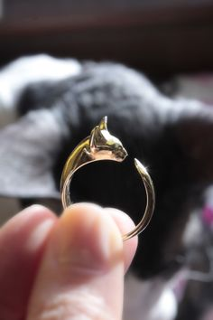 CORNISH REX RING: 'A delicate ring with a cat head. Gracefully curled tail tenderly holds up the ring on a finger. Available in rhodium-plated, white or black, sterling silver - gold plated - 18 carat gold. Cat Jewelry, Jewelry Design, Jewellery, Jewelry Rings, Handmade Walking Sticks, Cornish Rex Cat, Cat Ring, Cat Necklace, Delicate Rings