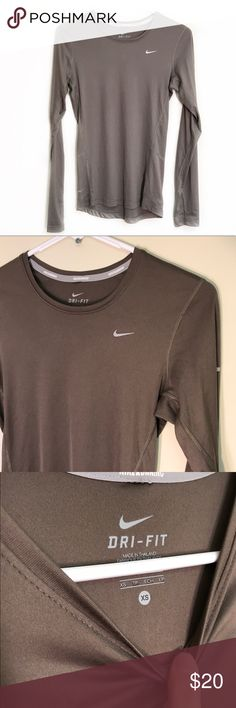 """NIKE Dri-Fit long sleeve running top size XS Excellent used condition without flaws. Nike dri-fit long sleeve running top in light brown color. Reflective material to sleeve and back neckline. Size XS. Armpit to armpit measures 16"""", length 24"""". Material is super soft and does have stretch. Nike Tops"""