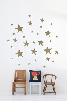 The good kind of wall decals - gold star wall stickers on white walls