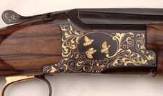 Thierry Duguet Engraver. Engraved Browning shotgun O/U, gold inlay ornaments and animals, right side.