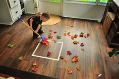 fall toddler activity raking leaves, can be changed into alot of other games
