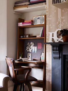A living room nook intended for book storage can be made into a workspace by adding a tall, narrow desk.