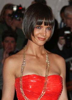 Pin for Later: 22 of the Most Memorable Looks From Met Galas Past Katie Holmes With her flapper bob and bronzed pink eye shadow, Katie Holmes was a perfect mix of modern and vintage at the 2008 Met Gala.