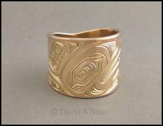 A wide gold Eagle Ring by David Neel, Kwakiutl. #nativeGoldRing #northwestCoastNativeWeddingRing #nativeAmericanWeddingBand #firstNationsWeddingRing #nativeIndianWeddingBand www.davidneel.com Native American Wedding, Native American Jewelry, Native Indian, Native Art, Jewelry Art, Silver Jewelry, Jewellery, Eagle Ring, Haida Gwaii