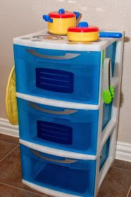 DIY play kitchen made from plastic drawers and adhesive vinyl.