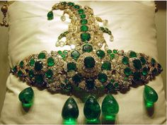 The Nizams' 'Sarpech', this spectacular turban ornament (sarpech) of the Nizams, dating back to the late 19th century, contains table-cut emeralds, old-cut diamonds, emerald drops and briolette diamonds set in gold. The total weight of the drops alone is estimated to be over 300 carats.